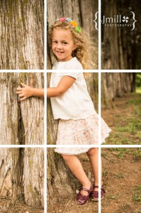 Girl posing by a tree