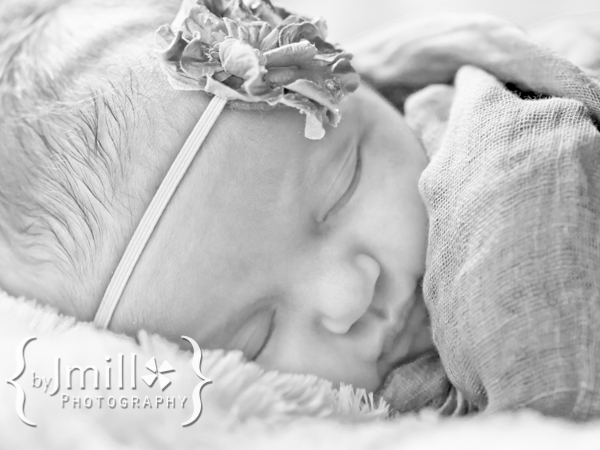 Black and white portrait of newborn baby sleeping
