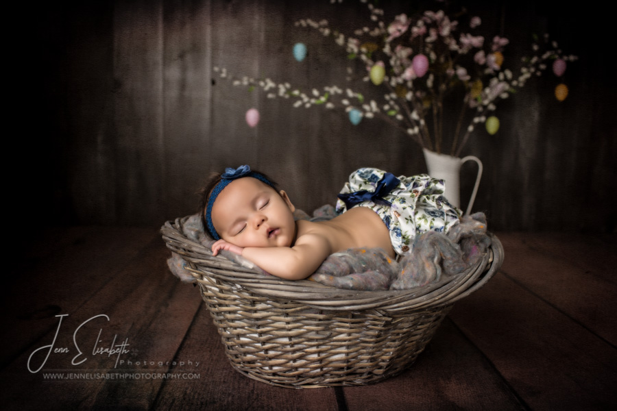 Portrait of baby girl in basket